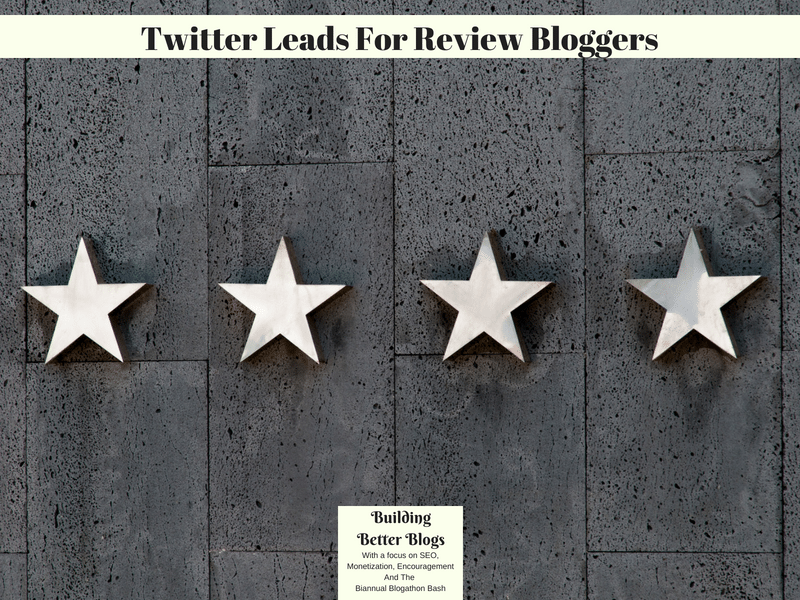 Four white stars on a grey wooden background.